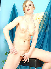 Ivory skinned milf Jarka spreads her pussy lips exposing her moist inner depths