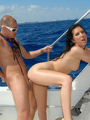 This cute brunnette amateur babe catches a nice double team here in these hot boat pix