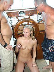 Cute blonde babe gets down and dirty with these guys on her first boat ride