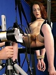 Madison Goode gets strapped into a bondage swing and penetrated by the fuck machine