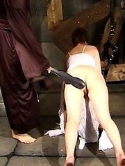 Lovely girl restrained and caned in dark dungeon - heavy welts and stripes