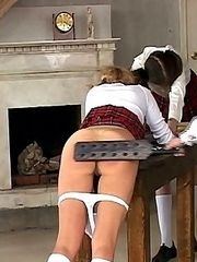 Pretty school girl with knickers around her ankles sticks out her pert bottom for a caning