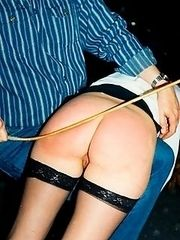Spanked in stockings over his knee - knickers pulled well down - burning buttocks