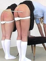 Two drunken sluts caned on their bare asses
