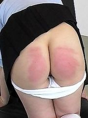 Hard wooden paddle meets soft round bottom - hot cheeks and tears