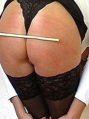 Caned wearing sexy black hold-ups for disobeying blonde