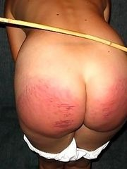 Naked blonde with badly bruised ass - brutal caning punishment