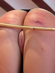 Dirty young slut bends over showing her asshole and hairless cunt to receive a heavy caning