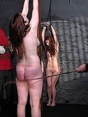 Redhead beauty relentlessly caned on her delicious bare ass - brutal dungeon beatings