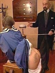 Pretty blonde girl caned to tears bent over the desk - heavy stripes and welts