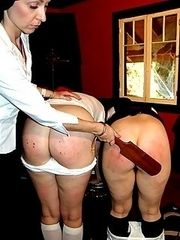 Double paddling punishment for two pretty girls with big round bottoms