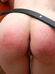Blonde babe stripped naked and brutally spanked with the belt