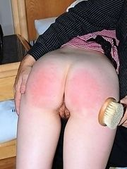Skinny babe gets a shameful bare bottom spanking with a heavy wooden brush