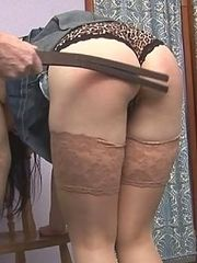 Beautiful brunette strapped and caned on her stunning ass