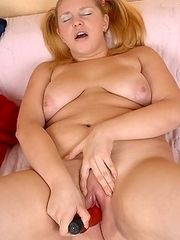 Cute chubby girl with sexy ponytails showing off her plump ass and pussy and dildoing on a couch