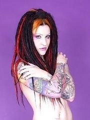 tattooed deathrocker strips off seethru dress
