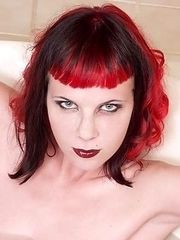 naked pierced redhead spookygoth girl takes a bath