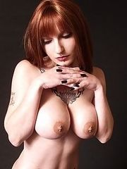 busty auburn beauty shows piercings tats pussy