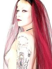 tattooed girl with long red hair loves guns