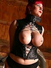 busty redhead in tight sexy bondage