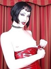collared goth chick in fishnets red latex dress