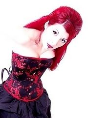 corset-clad hottie with cherry red hair