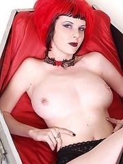 booted redhead rises from coffin and spreads legs