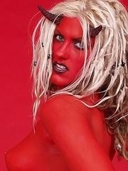 blonde painted red wearing horns of the devil