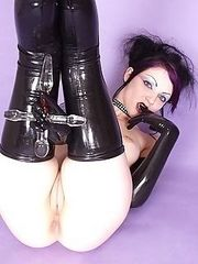 thigh high latex slut fucks self with glass cross