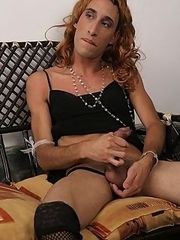 Crossdressed hunk stroking his big shaft while having a sexy phone talk