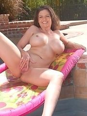 Hot and horny cougars showing off their bodies poolside