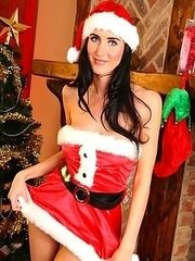 This stunning brunette will be making everyones xmas list in this strapless minidress and high heels.