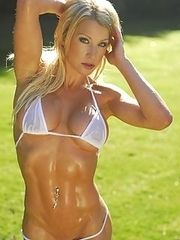 Sexy muscular girls in bikini and heels.