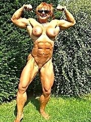 Muscle babe exposing her big clit.