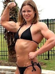 Muscle blonde in a bodysuit.