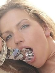 Watch cum dripping out of this beautiful model as she fucks herself with a glass sex toy...