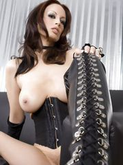 Brunette bombshell,Nikki Nova,gets naughty in her sexy thigh high boots and leather corset showing off her beautiful tits and sweet pussy!