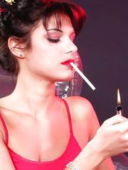 Smoker brunette tramp oiling and fucking her massive red dildo