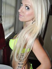 Awesome platinum blonde amateur cutie Shelby stripping green bra and showing her big melons