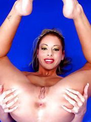 Acrobatic Russian blondie stripping and fingering her fuckable slit