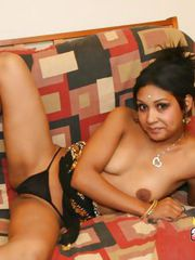 Round titted Indian slut stripping and showing her bald cunt