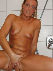 Skinny grandma Bettina fingers her pussy at the shower