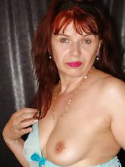 Redheaded grandma Christel strips and shows her boobies
