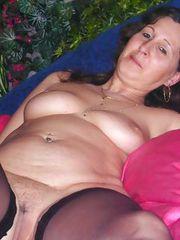 Lusty brunette grandma Melissa showing her nice boobies