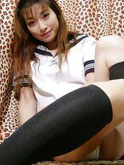 Sexy Japanese schoolgirl Kotono shows her perky tits