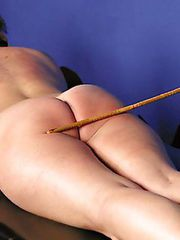Graziella gets gagged with her own panties before a terrific caning session